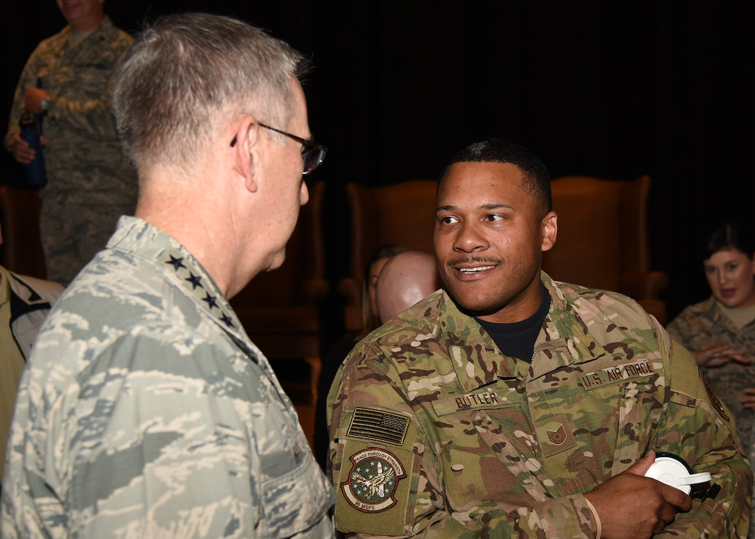 General John Hyten, commander of U.S. Strategic Command, talks with Tech Sgt. Pierce Butler from the 90th Mission Support Group, after an all-call at the F. E. Warren Air Force Base, Wyo., theater July 21, 2017. The Omaha Trophy is awarded to the best missile wing in USSTRATCOM. (U.S. Air Force photo by Glenn S. Robertson)