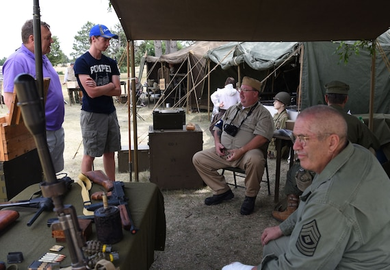 Scott Huff, a World War II re-enactor and photographer, talks about the history of Fort D.A. Russell Days at F.E. Warren Air Force Base, Wyo. July 21, 2017. In 1930, the fort's name was changed to Fort Francis E. Warren, and then to Francis E. Warren Air Force Base in 1949. This year marks the 150th anniversary of F.E. Warren Air Force Base, and the annual base open house brings military and civilian communities together to learn more about the base's rich history. (U.S. Air Force photo by Airman 1st Class Braydon Williams)