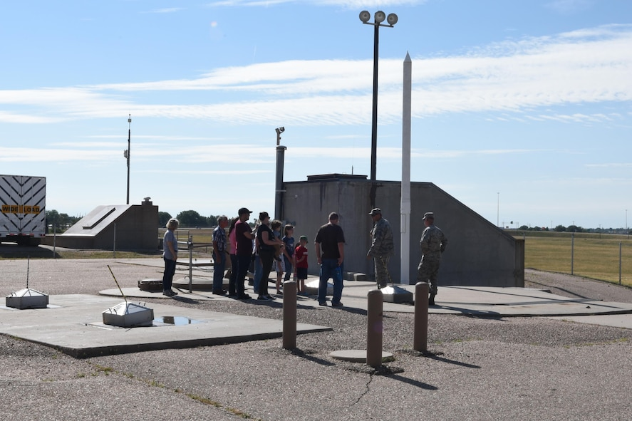 Tech. Sgt. Ruben Guerra, 790 MXS, section chief, talks to members of a tour of Uniform-01, a Minuteman III ICBM launch facility trainer during Fort D.A. Russell Days, at F.E. Warren Air Force Base, Wyo., July 22, 2017.  These types of tours allow the public to see what launch facilities look like throughout Nebraska, Wyoming and Colorado. (U.S. Air Force photo by Terry Higgins)