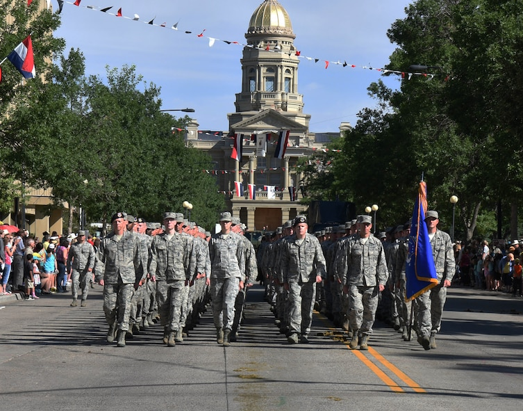 Airmen from the 90th Missile Wing march in formation during the 121st Cheyenne Frontier Days opening grand parade in Cheyenne, Wyo., July 22, 2017. Service members from multiple branches took part in the parade. This year marks the 150th anniversary of F.E. Warren Air Force Base and the city of Cheyenne. The two communities came together to celebrate during the 121st CFD rodeo and festival. (U.S. Air Force photo by Airman 1st Class Breanna Carter)