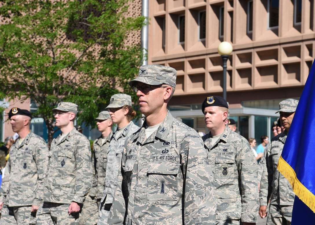 Col. Greg Buckner, 90th Maintenance Group commander, leads a formation of Airmen from the 90th Missile Wing during the 121st Cheyenne Frontier Days grand opening parade in Cheyenne, Wyo. July 22, 2017. Buckner has been in the Air Force since 1994 and arrived at F.E. Warren Air Force Base in 2016. This year marks the 150th anniversary of F.E. Warren Air Force Base and the city of Cheyenne. The two communities came together to celebrate during the 121st CFD rodeo and festival. (U.S. Air Force photo by Airman 1st Class Braydon Williams)