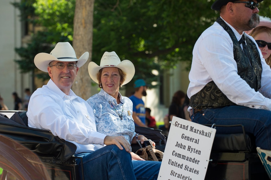 U.S. Air Force Gen. John E. Hyten, U.S. Strategic Command commander and his wife Laura, ride along Capitol Avenue during the 121st Cheyenne Frontier Days opening grand parade in Cheyenne, Wyo., July 22, 2017. Hyten was invited to be the grand marshal of the parade and opening ceremonies which officially mark the beginning of CFD. This year marks the 150th anniversary of F.E. Warren Air Force Base and the city of Cheyenne. The two communities came together to celebrate during the 121st CFD rodeo and festival. (U.S. Air Force photo by Staff Sgt. Christopher Ruano)