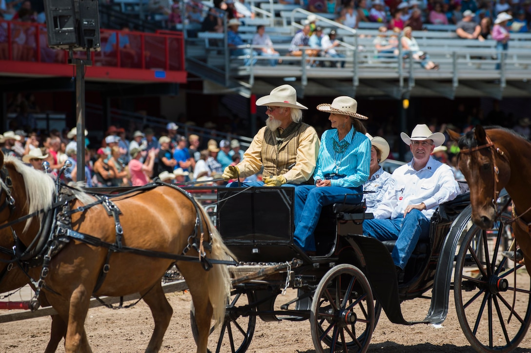 U.S. Air Force Gen. John E. Hyten, U.S. Strategic Command commander rides into Frontier Park for the Cheyenne Frontier Days grand entrance ceremony in Cheyenne, Wyo., July 22, 2017. Hyten's grand entrance marks the official start of the two week-long event. This year marks the 150th anniversary of F.E. Warren Air Force Base and the city of Cheyenne. The two communities came together to celebrate during the 121st CFD rodeo and festival. (U.S. Air Force photo by Staff Sgt. Christopher Ruano)