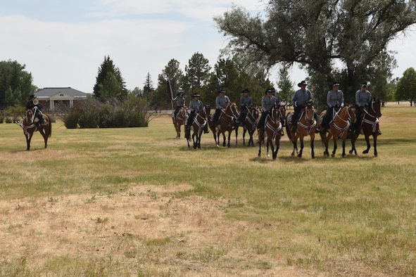 Members of the Trotters Equestrian team perform during Fort D.A. Russell Days, at F.E. Warren Air Force Base, Wyo., July 22, 2017.  The performance is a demonstration of historical cavalry precision riding drills. (U.S. Air Force photo by Terry Higgins)