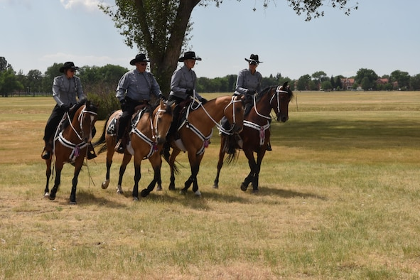 Members of the Trotters Equestrian precision riding team demonstrate their skills during Fort D.A. Russell Days at F.E. Warren Air Force Base, Wyo., July 22, 2017. The Trotters performance is an annual tradition. (U.S. Air Force photo by Terry Higgins)