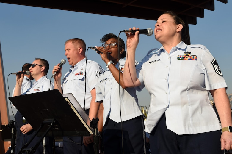 Senior Airman Will Thorton, Tech Sgt. Josh Keen, and Master Sgt.'s Erika Stevens and Shonda Mashburn, Band of the Southwest vocalists, perform a medley of songs by famous composer William Grant Still during a show June 29 in Sedona, NM. The performance featured music from other American composers, Hollywood legends, and well-known blockbusters. (Texas Air National Guard photo by Staff Sgt. Kristina Overton)