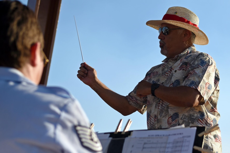 Sandy Moriarty, the mayor of Sedona, NM, guest conducts a piece of music during a performance June 29 at Posse Ground Park. Throughout the show, the band incorporated selections from Star Trek, Star Wars, Guardians of the Galaxy, and Beauty and the Beast, as well as pieces from famous composers William Grant Still and John Phillip Sousa. (Texas Air National Guard photo by Staff Sgt. Kristina Overton)