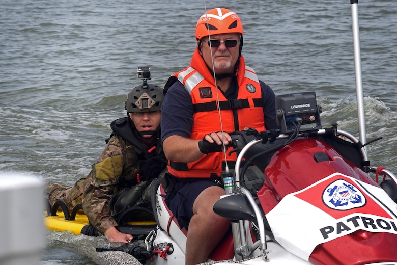 Master Sgt. James Henderson, 181st Weather Flight special operations weatherman, rides with a U.S. Coast Guard Auxiliary member to drop off his parachute gear after a deliberate water drop into Lake Worth in Fort Worth, Texas, May 20, 2017. The mission allowed 12 service members to parachute out of a C-130 Hercules from an altitude of 1000 feet into Lake Worth using MC-6 parachutes. (Texas Air National Guard photo by Staff Sgt. Kristina Overton)