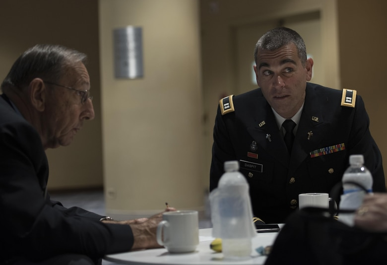 Capt. Doug Daspit (right), U.S. Army Reserve chaplain for the 321st Sustainment Brigade located in Baton Rouge, Louisiana, sits with chaplain endorser, George Paul, after receiving the Chaplain of the Year award during the Reserve Officers Association National Convention in Crystal City, Virginia, July 22, 2017. Daspit was nominated for his response to recent Baton Rouge floods, providing one-on-one pastoral counseling to 38 Soldiers and their affected families. (U.S. Army Reserve photo by Sgt. Audrey Hayes)