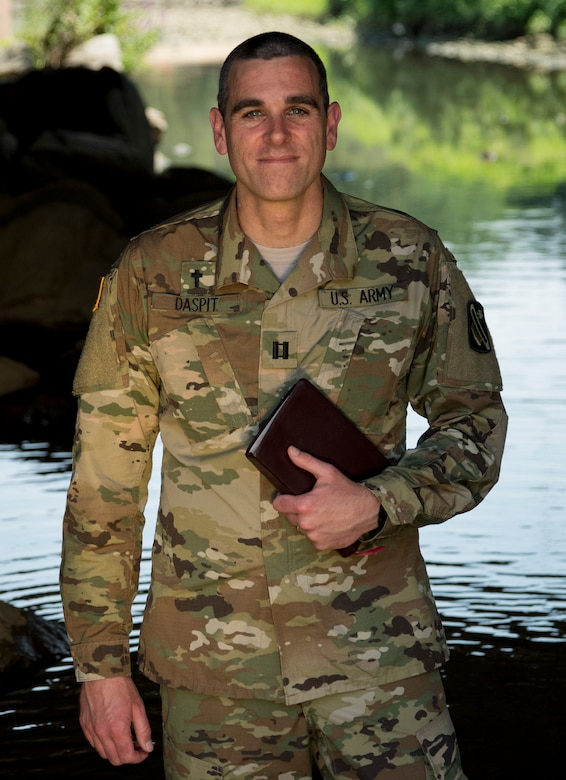 Capt. Doug Daspit, U.S. Army Reserve chaplain for the 321st Sustainment Brigade located in Baton Rouge, Louisiana, poses for a portrait in knee-deep water after receiving the Chaplain of the Year award during the Reserve Officers Association National Convention in Crystal City, Virginia, July 22, 2017. Daspit was nominated for his response to recent Baton Rouge floods, providing one-on-one pastoral counseling to 38 Soldiers and their affected families. (U.S. Army Reserve photo by Sgt. Audrey Hayes)