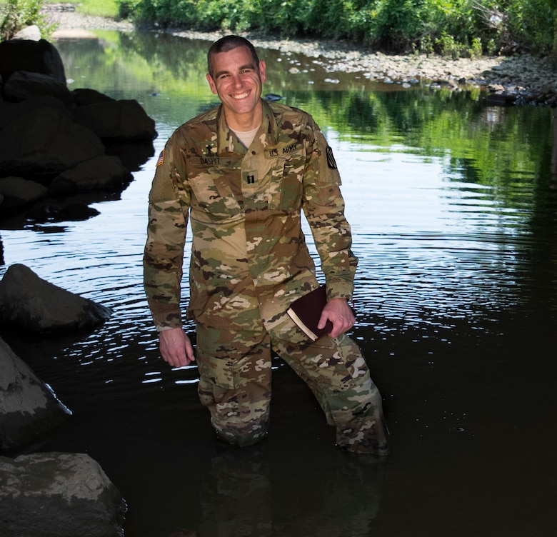 Capt. Doug Daspit, U.S. Army Reserve chaplain for the 321st Sustainment Brigade located in Baton Rouge, Louisiana, poses for a portrait in knee-deep water after receiving the Chaplain of the Year award during the Reserve Officers Association National Convention in Crystal City, Virginia, July 22. Daspit was nominated for his response to recent Baton Rouge floods, providing one-on-one pastoral counseling to 38 Soldiers and their affected families. (U.S. Army Reserve photo by Sgt. Audrey Hayes)