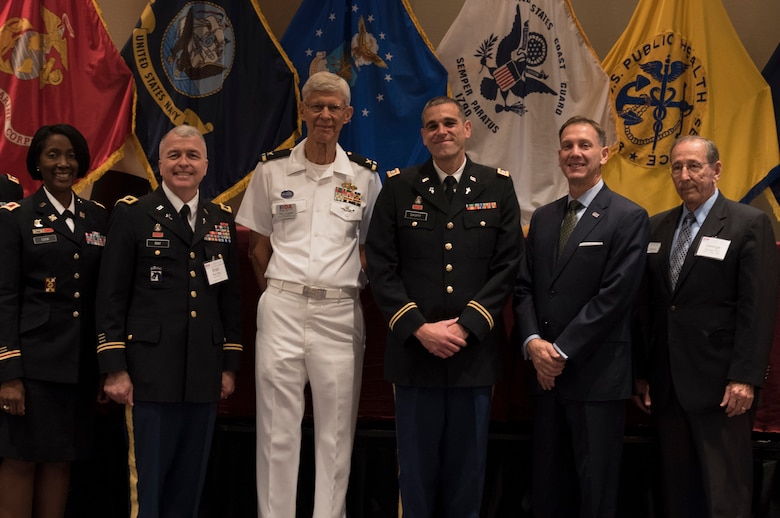 Capt. Doug Daspit (fourth from left), U.S. Army Reserve chaplain for the 321st Sustainment Brigade located in Baton Rouge, Louisiana, smiles for a picture after receiving the Chaplain of the Year award during the Reserve Officers Association National Convention in Crystal City, Virginia, July 22, 2017. Daspit was nominated for his response to recent Baton Rouge floods, providing one-on-one pastoral counseling to 38 Soldiers and their affected families. (U.S. Army Reserve photo by Sgt. Audrey Hayes)