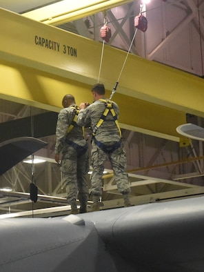 Staff Sgt. Michael Harlow (right) and Senior Airman Lance McDonald, aerospace maintainers with the 193rd Special Operations Wing, Middletown, Pennsylvania, ensure safety procedures are in place before inspecting an aircraft July 23, 2017. This aircraft inspection included a routine check of the No. 2 dry bay and the vertical boot. (U.S. Air National Guard photo by Senior Airman Julia Sorber/Released)