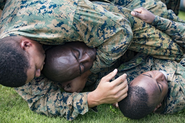 U.S. Marines with Marine Aviation Logistics Squadron (MALS) 12 grapple at Marine Corps Air Station Iwakuni, Japan, July 21, 2017. The USO hosted a field meet and cookout for MALS-12, which included several competitions such as grappling, pull-ups and a Humvee pull. (U.S. Marine Corps photo by Lance Cpl. Jacob A. Farbo)