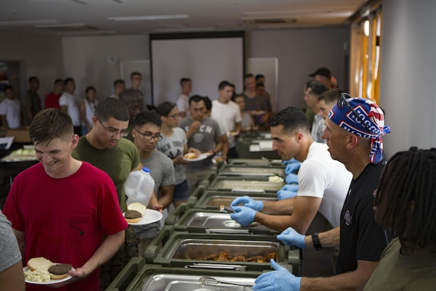 U.S. Marines with Marine Aviation Logistics Squadron (MALS) 12 attend a cookout sponsored by the USO on Marine Corps Air Station Iwakuni, Japan, July 21, 2017. The USO hosted a field meet and cookout for MALS-12, which included several competitions such as grappling, pull-ups and a Humvee pull. (U.S. Marine Corps photo by Lance Cpl. Jacob A. Farbo)