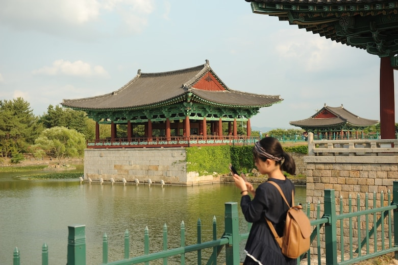 A visitor of the Donggung Palace and Wolji Pond takes a photo in Gyeongju, Republic of Korea, July 18, 2017. The Donggung Palace was built in 57 BCE and was a secondary palace, used for banquets and important national events. Nearly 100 United States Forces Korea members were invited by the Ministry of Patriots and Veterans Affairs to tour this location and other historic sites across the ROK as part of an initiative to give U.S. personnel a better understanding of Korean culture and patriotism. (U.S. Air Force photo by 1st Lt. Lauren Linscott/Released)