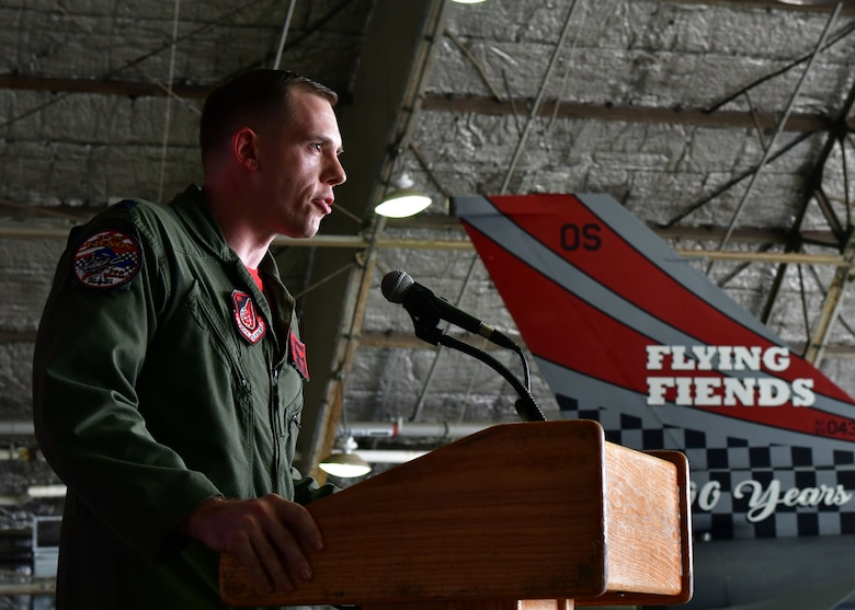 U.S. Air Force Capt. Wayne Mowery, 36th Fighter Squadron jet fighter pilot, speaks about the history of the 36th FS during a Tail Flash ceremony held July 21, 2017.Members from the 51st Maintenance Squadron Corrosion Control Shop painted the tail flash of an F-16 Fighting Falcon, which was unveiled during the ceremony in honor of the 36th FS's 100 years of service to the U.S. Air Force. (U.S. Air Force photo by Senior Airman Franklin R. Ramos/Released)