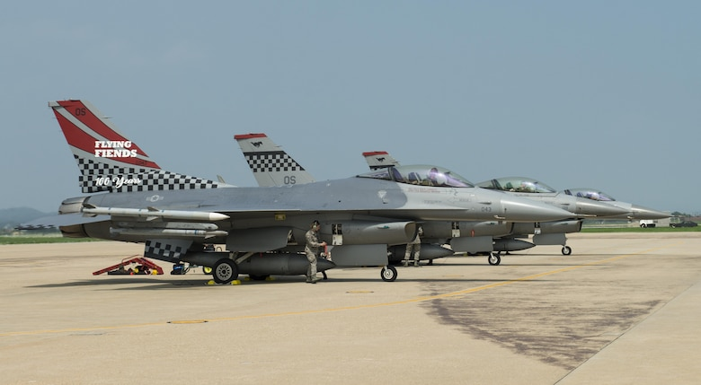 The 36th Fighter Squadron Flying Fiends centennial F-16 Fighting Falcon parks with two other F-16s at Osan Air Base, Republic of Korea, July 19, 2017. U.S. Air Force Col. Andrew P. Hansen, 51st Fighter Wing commander, flew the freshly painted jet for the first time during his final flight at Osan. (U.S. Air Force photo by Staff Sgt. Alex Fox Echols III)