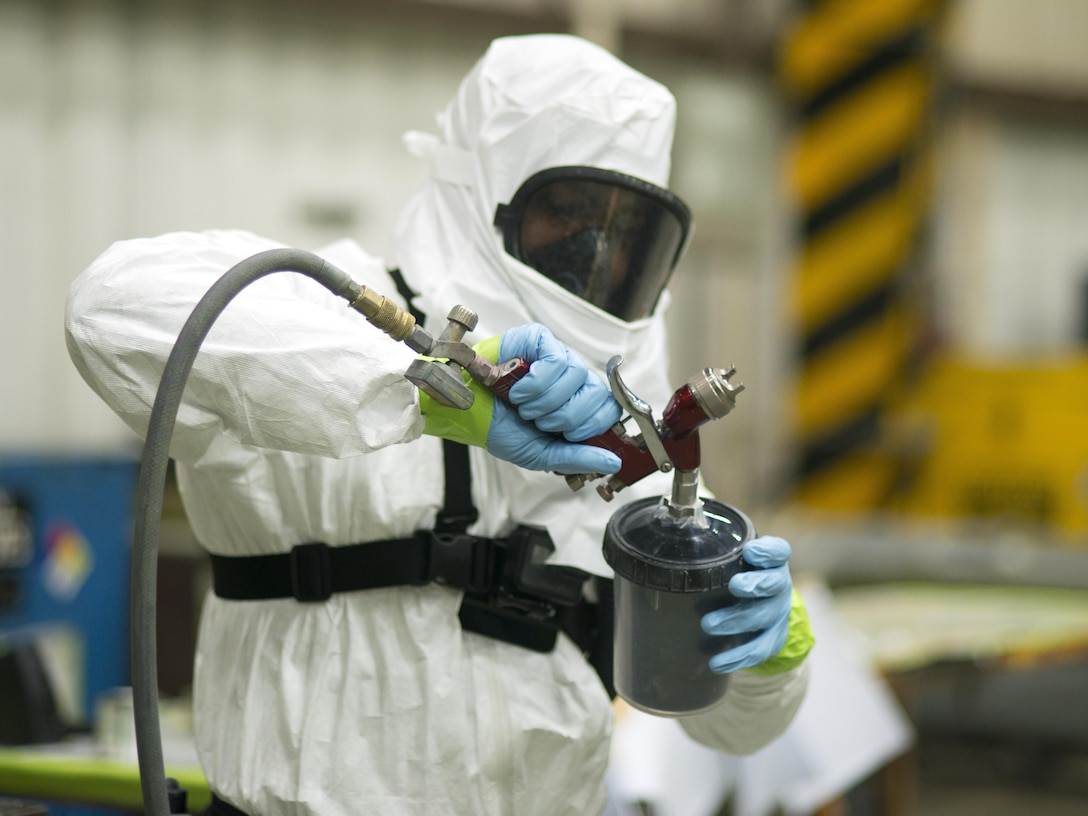U.S. Air Force Senior Airman William Williams, 51st Maintenance Squadron sheet metal and corrosion technician, loads a paint sprayer in the corrosion shop Osan Air Base, Republic of Korea, June 20, 2017. Williams was one of the members of Corrosion Control who expertly painted the 36th Fighter Squadron Flying Fiends Centennial F-16 Fighting Falcon. (U.S. Air Force photo by Staff Sgt. Alex Fox Echols III)
