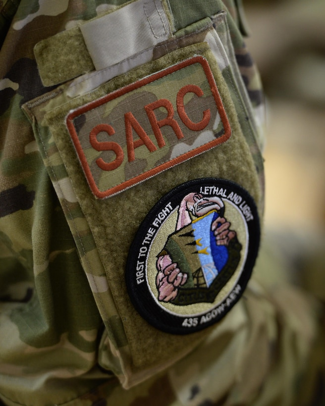"""Patches depicting """"SARC"""", Sexual Assault Response Coordinator, and the 435th Air Expeditionary Wing/Air Ground Operations Wing's flamingo mascot, stick to arm of 1st Lt. DeAndrea Jones, 435th AEW SARC. Jones travels to expeditionary locations in Africa under the 435th AEW to provide training and assistance to victim advocates, allowing victims of sexual assault to receive the help they need while deployed. (U.S. Air Force photo by Senior Airman Jimmie D. Pike)"""
