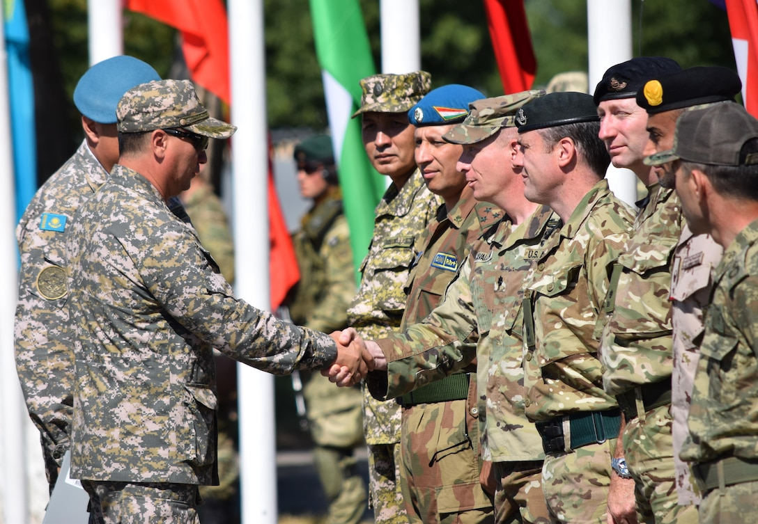 Maj. Gen. Murat Bektanov, Kazakhstan Land Forces commander, greets representatives from each nation participating in Exercise Steppe Eagle 17 during the opening ceremony July 22, 2017, at Illisky Training Center, Kazakhstan. (U.S. Army photo by Capt. Desiree Dillehay, 149th Military Engagement Team)