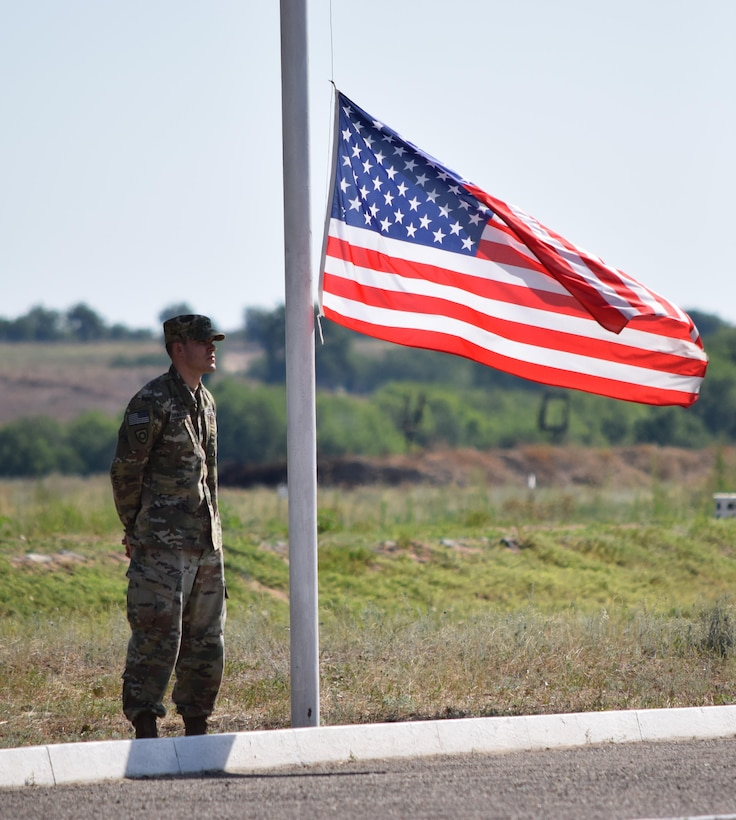 Staff Sgt. Daniel Dornbusch, 149th Military Engagement Team, stands ready to raise the American flag during the Exercise Steppe Eagle 17 opening ceremony July 22, 2017, at Illisky Training Center, Kazakhstan. Exercise Steppe Eagle is a premier multinational exercise focused on peacekeeping and peace support operations, while building relationships and mutual understanding between partner nations. (U.S. Army photo by Capt. Desiree Dillehay, 149th Military Engagement Team)