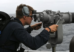 PACIFIC OCEAN (July 18, 2017) - Seaman Jonathan McConnell, assigned to USS Chaffee (DDG 90), looks through big eyes while standing watch as port look out. Chaffee is deployed in support of UNITAS 2017. UNITAS is an annual exercise that focuses on strengthening our existing regional partnerships and encourages establishing new relationships through the exchange of maritime mission-focused knowledge and expertise throughout the exercise.(U.S. Navy photo by Mass Communication Specialist 2nd Class Michael Hendricks/Released)