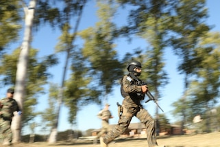 A competitor from Team Guatemala races toward his first target during a shooting event July 20, 2017, during Fuerzas Comando in Vista Alegre, Paraguay. Fuerzas Comando helps Guatemalan forces share and contribute to lasting stability and security in the Southern Hemisphere. (U.S. Army photo by Sgt. Joanna Bradshaw/Released)