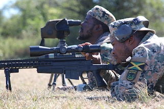 A Jamaican competitor adjusts the scope on his rifle during the FBI Shoot and Movers event July 19, 2017 as part of the Fuerzas Comando competition at Vista Alegre, Paraguay. The nations participating in the competition share a long history of working with each other. (U.S. Army photo by Sgt. 1st Class James Brown/Released)