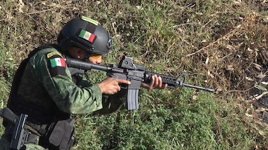 A Mexican competitor aims his weapon to prepare for a combined assault event July 22, 2017, during Fuerzas Comando in Cerrito, Paraguay. There are 20 teams competing in Fuerzas Comando that share a longstanding history of cooperation. (U.S. Army photo illustration by Pfc. Lauren Sam/Released) (This image was created by capturing a still frame from a video.)