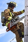 Airman 1st Class Adam Striejewske, 99th Civil Engineer Squadron firefighter, climbs a ladder during Red Flag 17-3 at Nellis Air Force Base, Nev., July 18, 2017. First responders climb ladders to reach the roof of a building and create holes during fires to help smoke easily escape the building. (U.S. Air Force photo by Airman 1st Class Andrew D. Sarver/Released)