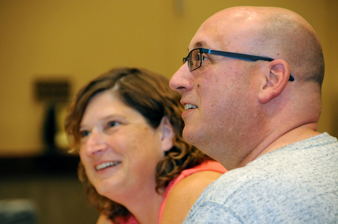 Staff Sgt. Brad Reese and his wife Dottie listen to introductions July 21 during a 99th Regional Support Command Strong Bonds event at the Kalahari Resort in Pocono Manor, Pennsylvania.  Reese is a human resources specialist with the Army Reserve's 11th Battalion, 98th Regiment.  Strong Bonds is a unit-based, chaplain-led program, which assists commanders in building individual resiliency by strengthening the Army Family. The core mission of the Strong Bonds program is to increase individual Soldier and Family member readiness through relationship education and skills training.