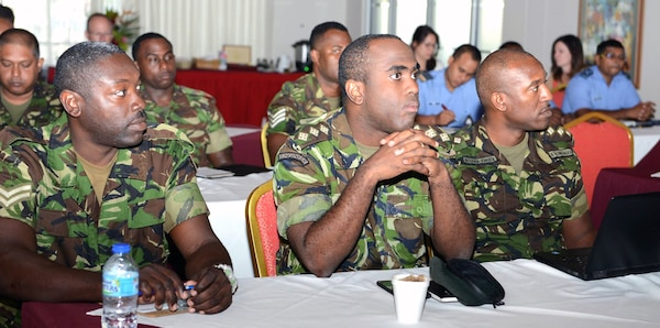 Soldiers from the Trinidad & Tobago Regiment listen to a presentation during a subject matter expert exchange focusing on energy and water conservation in Port of Spain, Trinidad, July 11.