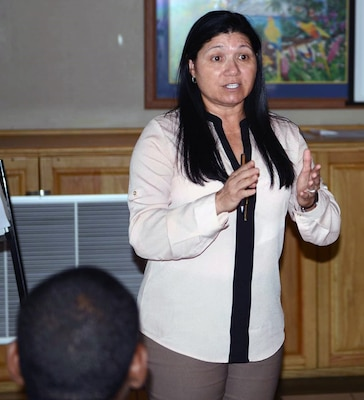 Rosa Santoni, Army South's facility and construction chief, addresses participants during day two of a subject matter expert exchange in Port of Spain, Trinidad, July 12.