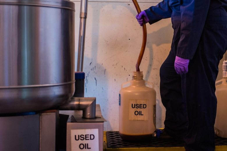 During the centrifugal process, used oil is spun from absorbent pads and collected in an exterior container. Once the oil is separated from the pads, it is consolidated to other barrels of used oil to be prepared for disposal. (U.S. Air Force Photo by Staff Sgt. Charles Dickens/Released)