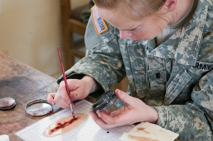 Army Reserve 1st Lt. Rebecca Milligan, of the Effects and Enablers Team, which is augmenting the 84th Training Command's Combat Support Training Exercise and the Army Medical Command's Global Medic Exercise headquartered out of Fort Hunter Liggett, California, paints a simulated injury for medical professionals to train on during mass casualty scenarios on Camp Roberts, California, July 16, 2017.