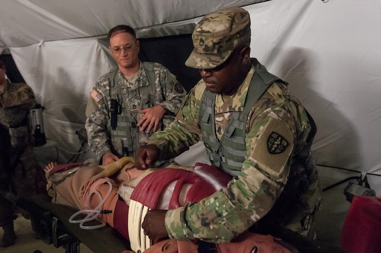 "Sgt. 1st Class Terry Warren, of the Effects and Enablers Team, which is augmenting the 84th Training Command's Combat Support Training Exercise and the Army Medical Command's Global Medic Exercise headquartered out of Fort Hunter Liggett, California, demonstrates a ""cut suit,"" a surgical suit meant to replicate realistic scenarios for medical professionals to train on during mass casualty exercises on Camp Roberts, California, July 16, 2017."