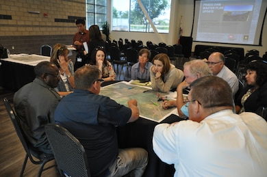 Corps archeologist Danielle Storey (center) facilitates discussion among representatives from flood control and water conservation districts, public works and utilities agencies, parks departments and the cities of Corona and Eastvale to ensure their concerns are considered in the update.