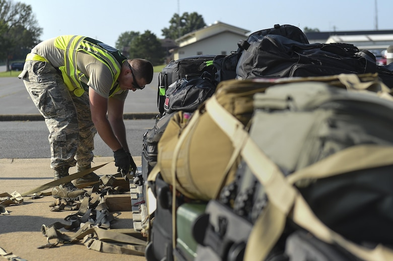 Senior Airman Troy Iversen, 19th Logistics Readiness Squadron aerial delivery rigger, secures baggage cargo onto a pallet July 20, 2017, at Little Rock Air Force Base, Ark. More than 3,000 Air Mobility Command Airmen will travel to Washington in order to participate in Mobility Guardian 2017, a massive exercise testing airlift and airdrop capabilities alongside 25 international partners. (U.S. Air Force photo by Staff Sgt. Harry Brexel)