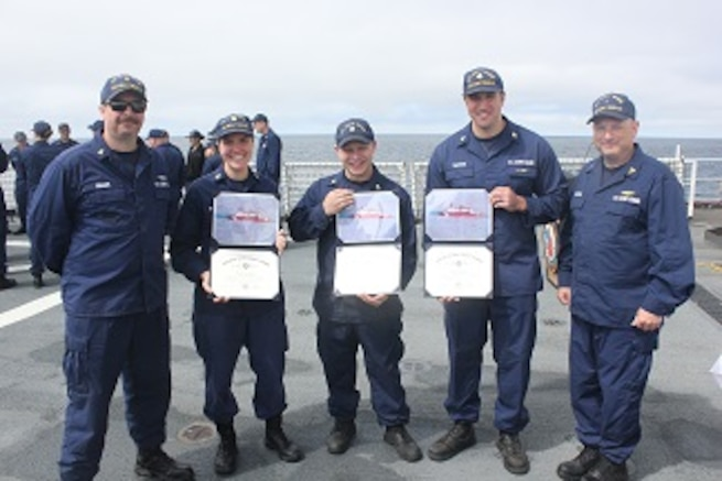 HEALY's Gold and Silver Ancient Mariners, ENG3 Rob Kopser and FSCS Cliff Grader stand with newly minted permanent cuttermen.