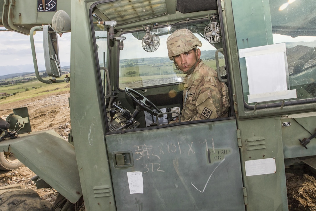 U.S. Army Reserve Soldier, Spc. Jonathan Baughn, 926th Engineer Battalion, Birmingham, Ala., uses construction equipment to move materials during Resolute Castle 17 at Cincu Romania, July 15, 2017. Baugh, a Rough Framer for Cavalier Homes, has traveled from his home in Jasper, Al., with his unit to help complete construction of a new training facility that will provide Allied forces the opportunity to prepare for potential conflict. The entire operation is led by U.S. Army Reserve engineers, who moved Soldiers and equipment from the U.S. to Romania over a period of several weeks to complete the training facility. Resolute Castle improves interoperability, enhances confidence and security assurance between partner nations, while improving infrastructure, capability and capacity at select locations throughout Europe. (U.S. Army Reserve photo by Staff Sgt. Felix R. Fimbres)