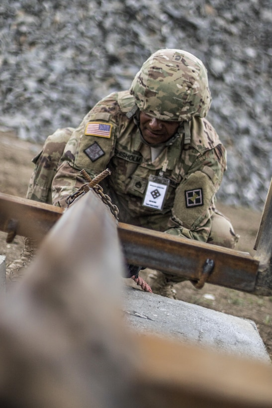 U.S. Army Reserve Soldier, Staff Sgt. Matthew Chisholm, Waycross, Ga., 381st Engineer Company, helps prepare movement of construction materials during Resolute Castle 17 at Cincu, Romania, July 15, 2017. Chisholm, who works in Law Enforcement traveled from his home in Way Cross, Ga., with his unit to help complete construction of a new training facility that will provide Allied forces the opportunity to prepare for potential conflict. The entire operation is led by U.S. Army Reserve engineers, who moved Soldiers and equipment from the U.S. to Romania over a period of several weeks to complete the training facility. Resolute Castle improves interoperability, enhances confidence and security assurance between partner nations, while improving infrastructure, capability and capacity at select locations throughout Europe. (U.S. Army Reserve photo by Staff Sgt. Felix R. Fimbres)