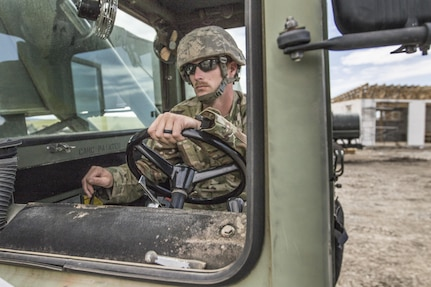 U.S. Army Reserve Soldier, Sgt. Travis Snelson, 733rd Engineer Company, Greenville, S.C., uses construction equipment to move a pallet of cinder blocks during Resolute Castle 17 at Cincu, Romania, July 15, 2017. Snelson owns a landscaping company in Asheville, N.C, and has traveled to Romania with his company to help complete construction of a new training facility that will provide Allied forces the opportunity to prepare for potential conflict. The entire operation is led by U.S. Army Reserve engineers, who moved Soldiers and equipment from the U.S. to Romania over a period of several weeks to complete the training facility. Resolute Castle improves interoperability, enhances confidence and security assurance between partner nations, while improving infrastructure, capability and capacity at select locations throughout Europe. (U.S. Army Reserve photo by Staff Sgt. Felix R. Fimbres)
