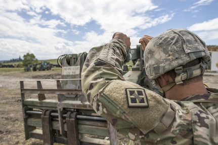 U.S. Army Reserve Soldier, Sgt. Byron Haynes, 733rd Engineer Company, Greenville, S.C. guides a U.S. Army Reserve Soldier, with hand signals, to move a pallet of cinder blocks during Resolute Castle 17 at Cincu, Romania, July 15, 2017. Haynes, who is a highway inspector, in South Carolina, traveled to Romania with his company to help complete construction of a new training facility that will provide Allied forces the opportunity to prepare for potential conflict. The entire operation is led by U.S. Army Reserve engineers, who moved Soldiers and equipment from the U.S. to Romania over a period of several weeks to complete the training facility. Resolute Castle improves interoperability, enhances confidence and security assurance between partner nations, while improving infrastructure, capability and capacity at select locations throughout Europe. (U.S. Army Reserve photo by Staff Sgt. Felix R. Fimbres)