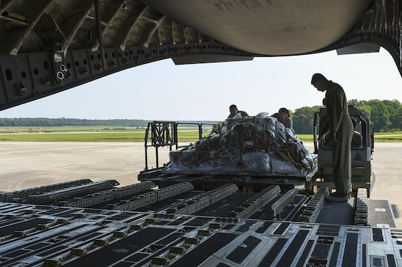 Aerial porters from the 19th Logistics Readiness Squadron load cargo onto a C-17 Globemaster July 23, 2017, at Little Rock Air Force Base, Ark. More than 100 Team Little Rock members will lead, coordinate and execute maintenance operations during Mobility Guardian 2017. The exercise will test each of Air Mobility Command's core competencies including airlift, aerial refueling, aeromedical evacuation and mobility support operations. (U.S. Air Force photo by Staff Sgt. Harry Brexel)