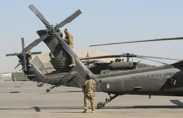 ERBIL, Iraq – Crew chiefs assigned to B Company,2-149th General Support Aviation Battalion, Task Force Saber, conduct post-flight inspections on UH-60M Black Hawk helicopters at Erbil, Iraq, July 11,2017. The UH-60M Black Hawk provides Task Force Saber the capability to conduct distinguished visitor movement, logistical movement and aeromedical evacuation throughout the area of operations for Task Force Saber and Combined Joint Task Force – Operation Inherent Resolve. CJTF-OIR is the Coalition to defeat ISIS in Iraq and Syria. (U.S. Army photo by Capt. Stephen James)