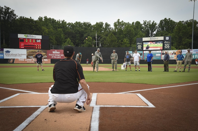 Several Airmen throw the ceremonial first pitch during Joint Base Andrews Military Appreciation Night hosted by the Bowie Baysox at the Prince George's Stadium, in Bowie, Md., July 21, 2017. Several military members participated in opening ceremonies including the presenting of the colors, singing the national anthem, and throwing out the ceremonial first pitch. (U.S. Air Force photo by Senior Airman Mariah Haddenham)