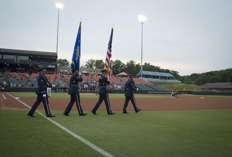 The Joint Base Andrews Honor Guard takes the field to display the colors during Joint Base Andrews Military Appreciation Night hosted by the Bowie Baysox at Prince George's Stadium, in Bowie, Md., July 21, 2017. Several military members participated in opening ceremonies including the presenting of the colors, singing the national anthem, and throwing out the ceremonial first pitch. (U.S. Air Force photo by Senior Airman Mariah Haddenham)