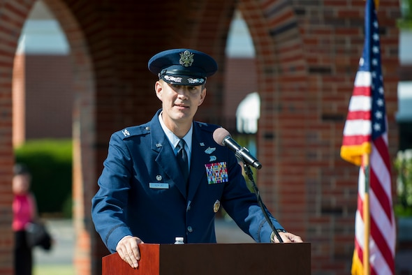 Col. John Howard, 375th Air Mobility Wing commander, speaks during the wing change of command ceremony July 24, 2017, at Scott Air Force Base, Ill. Howard is arriving from Royal Air Force Mildenhall where he served as the vice commander of the 100th Air Refueling Wing. (U.S. Air Force photo by Staff Sgt. Clayton Lenhardt)