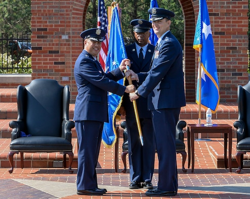 Lt. Gen. Giovanni Tuck, 18th Air Force commander, presents the 375th Air Mobility Wing guidon to Col. John Howard, signifying the start of his command of the wing during a change of command ceremony July 24, 2017 at Scott Air Force Base, Ill. Howard arrived from Royal Air Force Mildenhall, England, where he served as the vice commander for the 100th Air Refueling Wing. (U.S. Air Force photo by Airman Chad Gorecki)